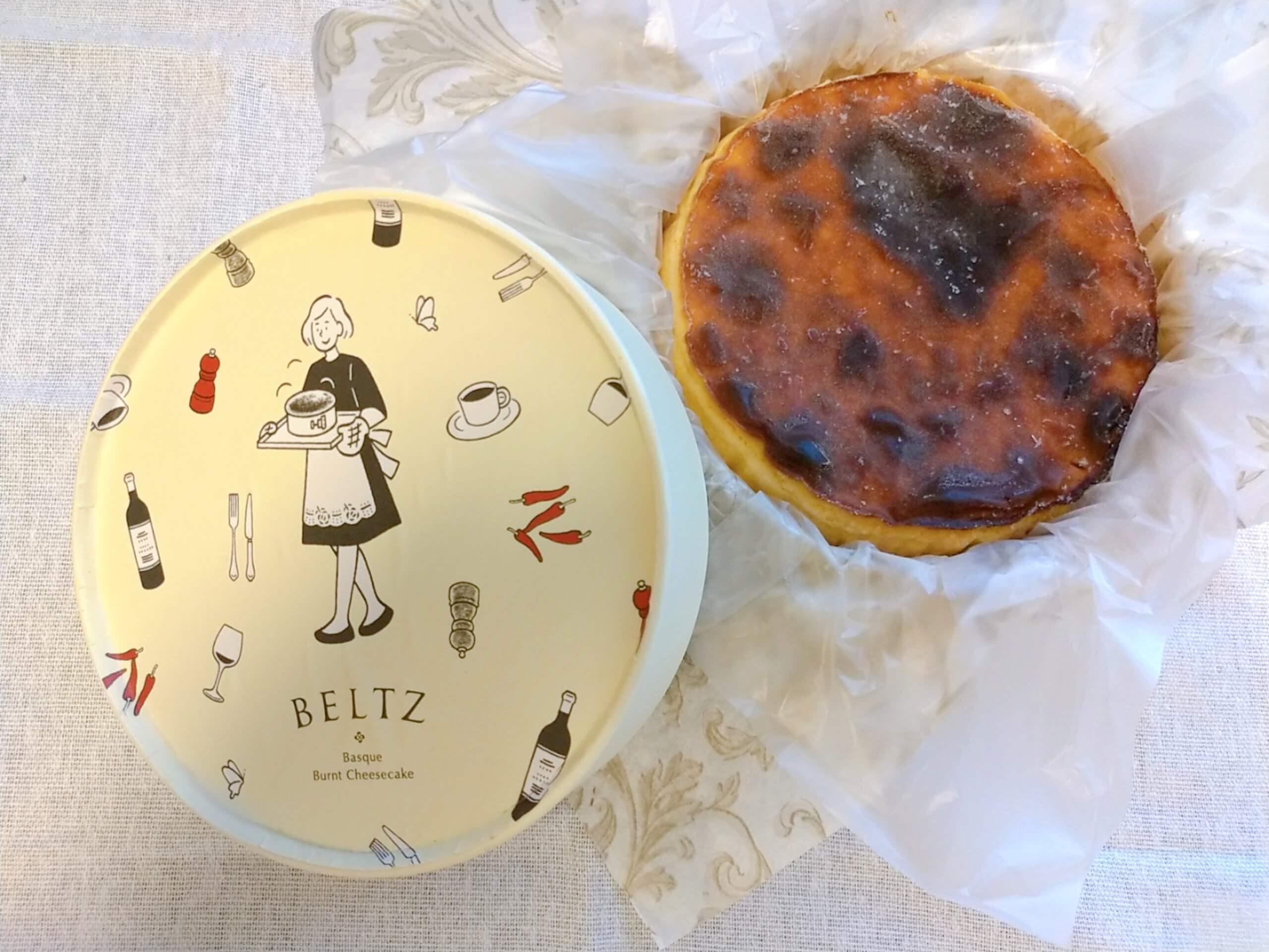 ベルツのチーズケーキと女の子のパッケージ